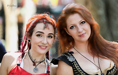 Beautiful Duo (wyojones) Tags: costumes woman usa cute girl beautiful smile look festival dreadlocks scarf us necklace dangerous eyes pretty texas expression gorgeous lips redhead greeneyes faire acrobat nosering earrings lovely renaissancefestival collar fest redhair performer renfest wench headdress waxahachie nosepiercing earpiercing scarby nosepiercings scarbourghfaire wyojones blrowneyes