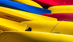 Kayak Crisscross (Jerry Fornarotto) Tags: red orange color green sport yellow boat rainbow dock colorful kayak exercise bright vessel row hobby canoe kayaking rowing recreation nautical canoeing paddling multi lined funsign jerryfornarotto