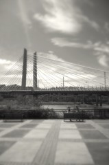 People by the 'Bridge of the People' (TMimages PDX) Tags: city bridge urban blackandwhite usa monochrome architecture oregon river portland geotagged photography photo waterfront image explore photograph suspensionbridge willametteriver fineartphotography flickrexplore cablestayedbridge explored iphoneography tilikumcrossing