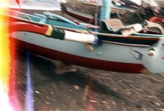 26-537 (ndpa / s. lundeen, archivist) Tags: bali color film beach 35mm indonesia boats coast blurry sand village 26 painted nick outoffocus lightleak coastal southpacific watersedge 1970s fishingboats 1972 indonesian balinese dewolf oceania pacificislands burnframe nickdewolf beginningoftheroll pumpboats photographbynickdewolf beginningofroll burnedshot burnedframe burnshot reel26