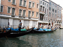 Gondelier (Jae at Wits End) Tags: city blue venice urban italy building window water glass architecture outside boat canal italian europe exterior ditch outdoor tourists structure vehicle gondola venetian opening portal explorers metropolitan travelers waterway gondolier sightseers