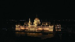 Hungary Parliament (oxfordblues84) Tags: reflection building water architecture river evening europe hungary nightlights budapest parliament landmark danube pest afterdark danuberiver orszghz gothicrevival vikingrivercruise 5photosaday hungaryparliament