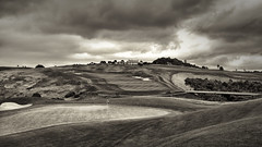 Giant Steps (Regan McCaffery) Tags: bridge newzealand bw storm grass clouds golf olympus greens warrior fairway northland 9th 8th clubhouse omd bunkers giantsteps em5 kauricliffs lumixgvario714f40