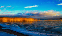 Winter sunset light (Joni Mansikka) Tags: winter nature outdoor landscape sunset light colours blue sky clouds ice shore sea piikkiö suomi finland