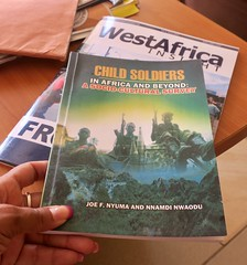 "Books that you can read at the Liberian embassy in Abuja while waiting for your visa. There are still many child soldiers in Africa 😞😔 Nigeria  Dec 2016 #itravelanddance • <a style=""font-size:0.8em;"" href=""http://www.flickr.com/photos/147943715@N05/31693446936/"" target=""_blank"">View on Flickr</a>"