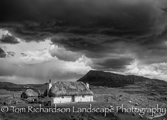 Cottage under Eaval (tomrichardson931) Tags: landscape mountains moors picturesque monochromephotography thatchedcottage countryside scene whitehouse scotland eaval northuist scenic westernisles outerhebrides cladachchairnis moorland thatch uk traditional edinburgh unitedkingdom gb