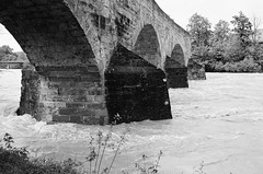 Bridge (Ursus Bear) Tags: canon eos 650 analog ef 3570 f3545 ilford xp2 400 35mm 135 monochrome bw blackwhite black white film monochromatic blackandwhite mono chrome ilfordxp2400super bwfp bridge river flood rock