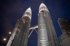 Landmark (slow paths images) Tags: malaysia southeastasia kualalumpur petronas towers skyscrapers landmark city night lights 4519m1483fthigh twintowers skybridge travel fredcan