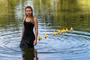 Rubber Duckies (BrianGoPhoto) Tags: birds ducks pond rubber rubberducks water woman