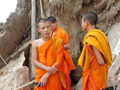 Buddhist Monks at Pak Ou Caves Laos (shaire productions) Tags: travel people orange cliff mountains male men tourism boys water beauty river asian religious photo asia southeastasia natural image buddhist religion picture teens monk buddhism guys hills caves photograph sacred limestone traveling laos robes buddhistmonks mekongriver namou pakou pakbeng tamtingcave