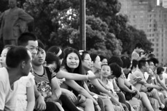 Sitting and relaxing at the Bund (Thorsten Reiprich) Tags: china city summer people urban blackandwhite travelling river evening asia crowd heat prc    embankment  jiang huangpu