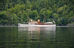Steam boat on the Loch Duich (Igor Sorokin) Tags: uk trees white lake reflection forest landscape scotland boat nikon ship scenic steamboat nikkor eileandonan waterscape lochduich 18300 sloap d7000