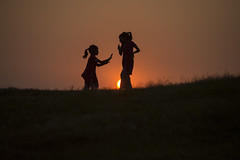 Kid tai chi (Photosightfaces) Tags: kids children sri lanka lankan silhouette srilankan srilanka taichi hands galle gallefort girl girls playing fun