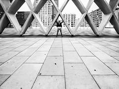 ΔΔΔΔΔ (CoolMcFlash) Tags: bw blackandwhite blackwhite person structure architecture construction city vienna austria streetphotography pattern urban donaucity dc donauplatte canon eos 60d lines geometry sw schwarzweis struktur architektur konstruktion stadt wien österreich muster linien geometrie fotografie photography woman frau sigma 1020mm 35 bnw