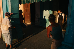 #20 Street & Repeat (f.d. walker) Tags: americas cuba habana havana lahabana latinamerica northamerica streetphotography street sunlight shadow sun candidphotography candid color clothes colorphotography contrast colors city people person man men woman women bow bowtie cafe restaurant light layers looking look hat hand