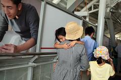 MALAY-6312 Sleeping on mum's shoulder (rose.vandepitte) Tags: kualalumpur malaysia publictransport mum sleepingkid hugtshirt hats poster