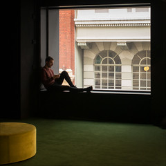 melbourne-6032-ps-w (pw-pix) Tags: interior corner quietcorner unfinished unused refuge shoppingcentre retail man boy person window light carpet seat round shape shadows pooloflight wall glass patterns colours reading resting relaxing cool windy summer morning green yellow black red white grey silhouette formeraustraliahotel formeraustraliaoncollins collinslane shopping newly developed refitted collinsstreet cbd melbourne victoria australia