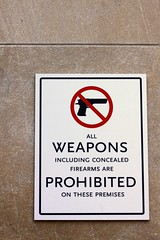 Weapons are Prohibited Sign (keith bissett) Tags: usa white black sign wall warning us gun no streetsign text unitedstatesofamerica mo kansascity forbidden piston weapon guns forbid ban prohibited weapons concealed prohibition firearm firearms prohibit canonslr notallowed redcircle canon50mmlens 50mmlens canonprimelens blacktext crossout allweaponsincludingconcealedfirearmsareprohibitedonthesepremises