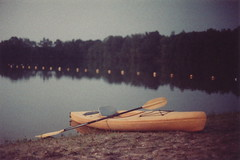 Summer days turn into summer evenings. (Kelly Marciano) Tags: summer lake film yellow analog 35mm reflections kayak depthoffield dreamy analogue canona1 filmgrain 100iso filmphotography westernmass summerevenings colornegativefilm adoxcolorimplosion100