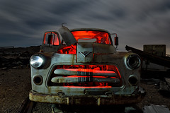 junkyard dodge. mojave desert, ca. 2016. (eyetwist) Tags: eyetwistkevinballuff eyetwist mojavedesert night pickup truck dodge junkyard abandoned dark longexposure long exposure fullmoon mojave desert nikon d7000 nikkor capturenx2 1024mmf3545g wideangle 1024mm npy nocturne highdesert americana americantypology american typology dead empty desolate lonely derelict decay shadow ruin lightpainting old vintage rust rusty southwest grille hood ornament windshield cracked patina headlights chrome carmageddon red orange v8 hoodornament logo badge barstow yermo california clouds moon moonlight urbex car