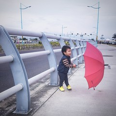 My red umbrella (Wenchieh Yang) Tags: sony 2016 wind kids children red umbrella sky light park we love taiwan