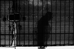 Untitled (ajkpix) Tags: street urban woman shadow bw blackandwhite gate fence losangeles california zeiss