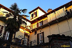 renovated old house (archgionni) Tags: buildings architecture house casa antica old giallo yellow finestre windows porte doors vetri glasses albero trees mattoni bricks balconi balconies luce light sole sun ombre shadows christiangroup