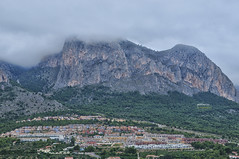 (033/17) En la ladera del Ponoig (Pablo Arias) Tags: pabloarias photoshop nxd cielo nubes españa arquitectura montaña paisaje ladera ponoig polop alicante comunidadvalenciana