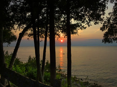 Sunset on the Lake (lefeber) Tags: trees sunset plants reflection silhouette wisconsin cottage lakemichigan eggharbor doorcounty northwoods