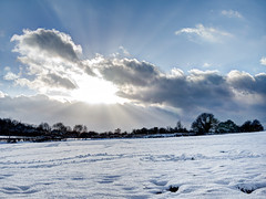 Romantic warm sunset (Graziano Vacca) Tags: olympus em10 panasonic 20mm 17 romantic sunrise sunset sunbeams snow snowy field winter december christmas cold hill clouds sky outdoor cloudy heaven sunlight wet ice slippery nature landscape