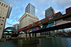 DLR Passing By Canary Wharf (Serge Freeman) Tags: canarywharf london england uk greatbritain dlr train bridge canal businesscentre buildings city architecture skyscrapers trainstation wideangle transport citylife urban