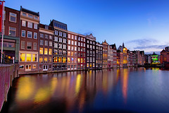 Ten seconds in Amsterdam (Pat Charles) Tags: amsterdam netherlands holland europe damrak travel tourism city urban exploration architecture reflection reflected reflections houses homes windows lights water canal nikon longexposure evening dusk bluehour outdoor outside icon iconic view sunset explore explored