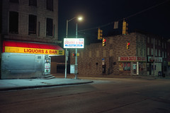 (patrickjoust) Tags: johnstonsquare baltimore maryland chickencastle restaurant cornerstore fujicagw690 kodakektar100 6x9 medium format 120 rangefinder 90mm f35 fujinon lens kodak c41 color film cable release tripod long exposure night after dark manual focus analog mechanical patrick joust patrickjoust east md usa us united states north america estados unidos autaut urban street city liquors bar corner store