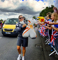 Torch Relay Out Runner (Beardy Vulcan) Tags: road boy summer england woman girl sunglasses out children toy outdoor flag crowd july hampshire mascot torch policewoman winchesterroad runner unionjack unionflag relay minibus 2012 basingstoke cuddlytoy wenlock torchrelay a30 london2012 metropolitanpolice wpc metpolice outrunner