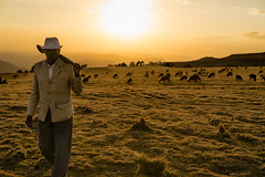 Always looks your best... even in the mountains and the fields. (departing(YYZ)) Tags: africa travel portrait people animals zeiss nationalpark sony suit 55mm weapon ethiopia simienmountains sonnartfe55mmf18zalens