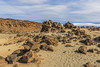 The stones on the sand (Ivanov Andrey) Tags: mountain volcano hill slope valley desert lava rock sky clouds horizon stone sand island yellow sulfurblack sun noon blue landscape perspective path road ascent descent shadow mountainrange mountainpeak nature travel tourism spain canaryislands tenerife teide