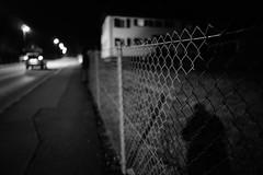 Night shadow (stefankamert) Tags: stefankamert street night shadow sony a7 sonya7 ilce7 highiso blurred blur noir noiretblanc blackandwhite blackwhite lights sel28f20 fe28mmf2 alienskin exposure fullframe mirrorless dof grain