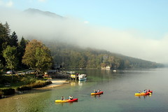 Setting Off (Alan1954) Tags: slovenia kayaks water red yellow mist lake holiday 2016 lakebohinj platinumpeaceaward
