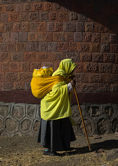 Ethiopian monk woman walking with a heavy bag on her back, Amhara region, Lalibela, Ethiopia (Eric Lafforgue) Tags: adult africa african africanethnicity amhararegion brightcolour christianity colourpicture culture day developingcountry eastafrica ethio17344 ethiopia ethiopian fulllenght hornofafrica lalibela oneadultonly oneperson oneseniorwomanonly onewomanonly onlywomen orthodox outdoors people photography pilgrimage religious ruralscene semienwollo senioradult shawl standing stick timkat timket timqat traditionalclothing traditionalculture vertical walking women et