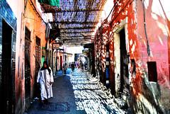 Marrakech (Manlio'77) Tags: street light people woman sun colors lightsandshadows colorful shadows islam streetphotography sunny morocco arab maroc marocco marrakech vicolo contrasts beautifullights strongcontrasts smallstreet