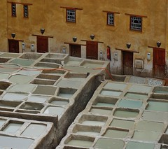 alternating rhythms (SM Tham) Tags: africa morocco fes feselbali oldmedina leathertanneries tubs vats water building wall facade doors windows fireextinguisher outdoors unescoworldheritagesite chouaratannery walllights