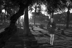She Walks Among the Tombstones (Laveen Photography (aka cyclist451)) Tags: az arizona douglaslsmith firstpresbyterianchurch greenwoodmemorylawn january laveenphotography phoenix vanburen week1 architecture cemetery cyclist451 door downtown graves ornate photograph photographer photography sunrise unitedstates blackwhite bw friend laneschwartz leslie model modeling muse ghost specter dawn blackandwhite