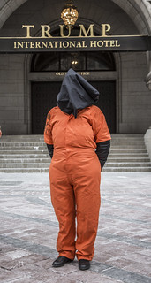 An Anti-Torture Activist Dressed as a Guantánamo Detainee Takes Part in a Demonstration Outside Trump International Hotel in Washington, DC