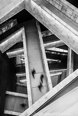 B+W Set Two - 2 (burntpixel.ca) Tags: canada manitoba winnipeg photo photograph fine art patrick mcneill burntpixel wrench777 beautiful spectacular landscape vertical monochrome black white sony a7r2 a7rii human rights museum walkways hallways pathways people walking angles diagonal layers architecture
