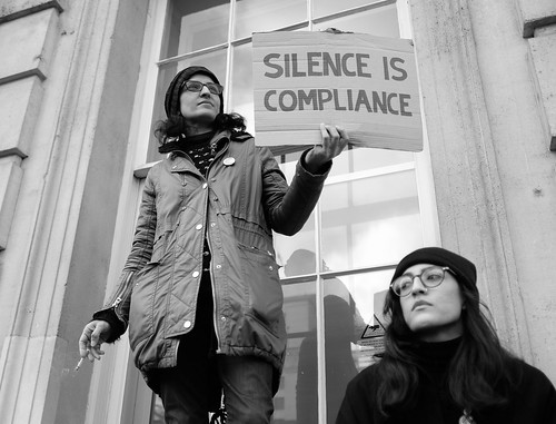 Silence is compliance - A protester with a message