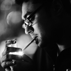 Lumière de l'amant (N A Y E E M) Tags: farhaan aashiq friend barmate candid portrait cigarette fire light smoke lastnight yesterday baikalbar hotel radissonblu chittagong bangladesh availablelight indoors square cropped handheld