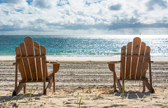 bring the beer (-gregg-) Tags: bahamas beach clouds sky chairs sand grass