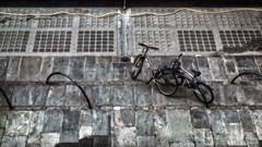 Wheels (Anne Worner) Tags: anneworner ononesoftware bike bikestand electricwire fromabove glasstiles grain inthestreet parked pavement retrolook seat slate slatetiles smear sprocket street wheel wideformat