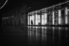 ...lonely... (*ines_maria) Tags: streetphotography street vienna at urban urbanart city light alone woman walking reflection panasonicdmcgx8 dark bw blackandwhite blancetnoire mono monochrome