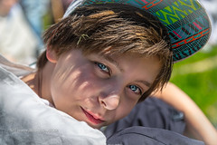 sitting boy with base cap looking into the camera (Armin Staudt) Tags: light boy portrait man male closeup sitting break looking outdoor sunny teen lazy cap teenager pause caucasian